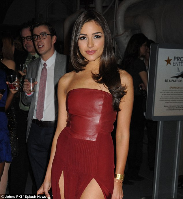Thigh-high: Olivia certainly hadn't opted for the demure look, leaving little to the imagination in the racy dress