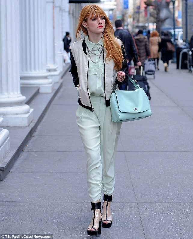 Too cool: Bella Thorne rocks mint green and Perspex heels on a day out in New York City