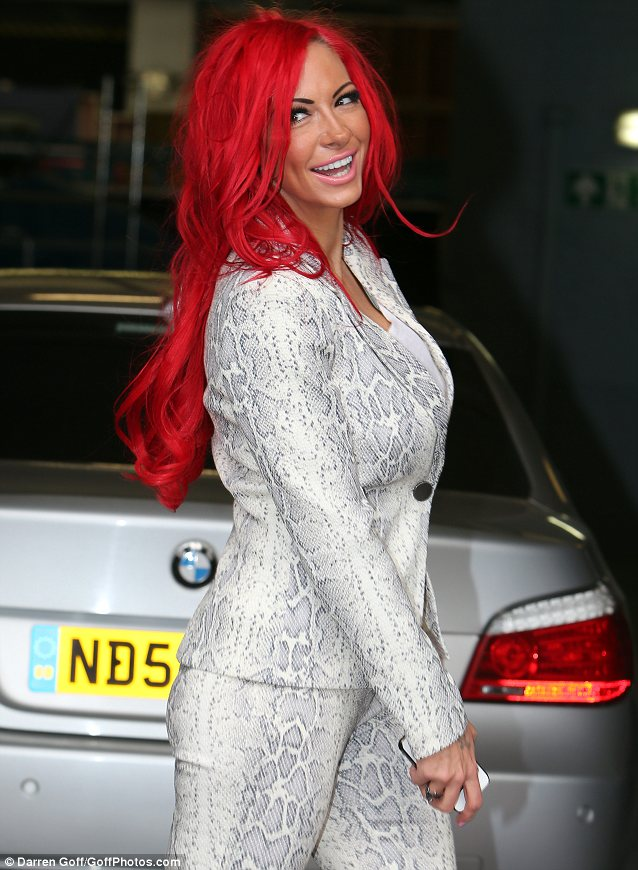 Scarlet lady: Jodie's red hair looked rather windswept as she arrived to the ITV studios