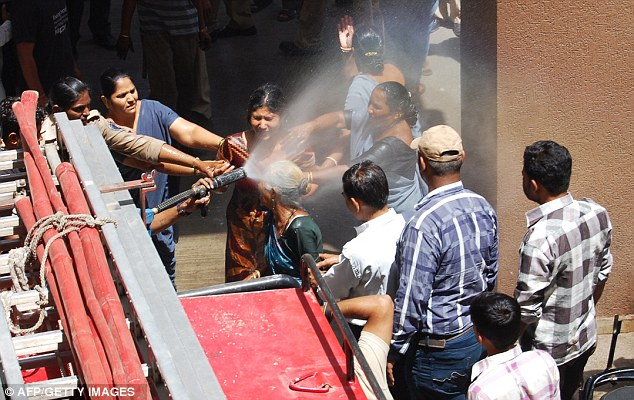 Intervention: Two of the Mansinghs are doused in water to stop their suicide