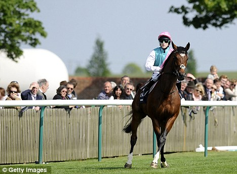 Tom Queally rides Frankel, trained by Sir Henry Cecil, at Newmarket racecourse in April 2011