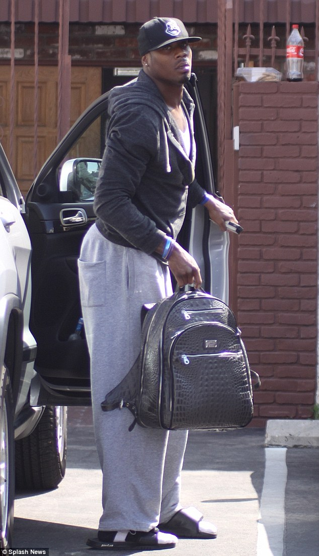 Nice bag: Jacoby Jones carried a snakeskin backpack as he arrived for rehearsal