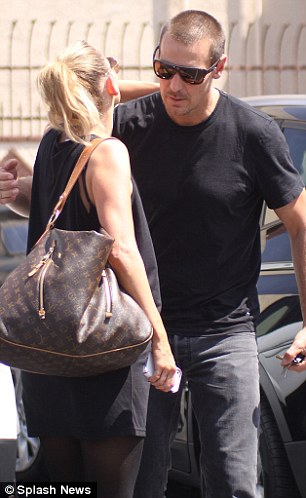 Leaning in: Partners Kym Johnson and Ingo Rademacher appeared happy to see each other as they greeted each other with a hug