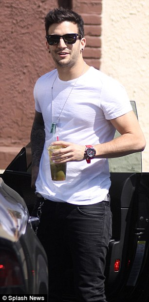 Cool and casual: Mark Ballas looked stylish in a white T-shirt and black jeans as he got out of his car