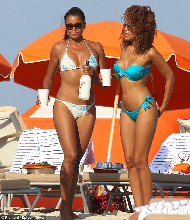 Slim and trim: The friends earlier showed off their stunning bikini figures as they indulged in a drop of Malibu rum