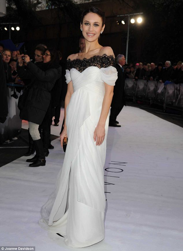 Snow queen: Olga Kurylenko dazzled in a flowing white dress with black lace detail around the neckline at the London premiere of Oblivion