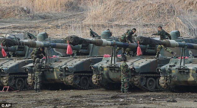 South Korean marines work on their K-55 self-propelled howitzers during an exercise against possible attacks by North Korea near the border village of Panmunjom in Paju, South Korea, on Wednesday