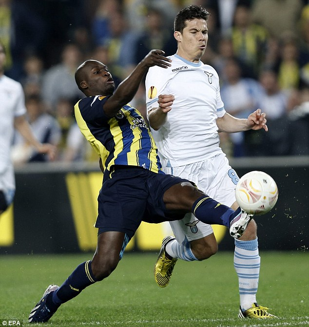 Making the challenge: Fenerbahce's Pierre Webo (left) challenges for ball against Lazio's Hernanes