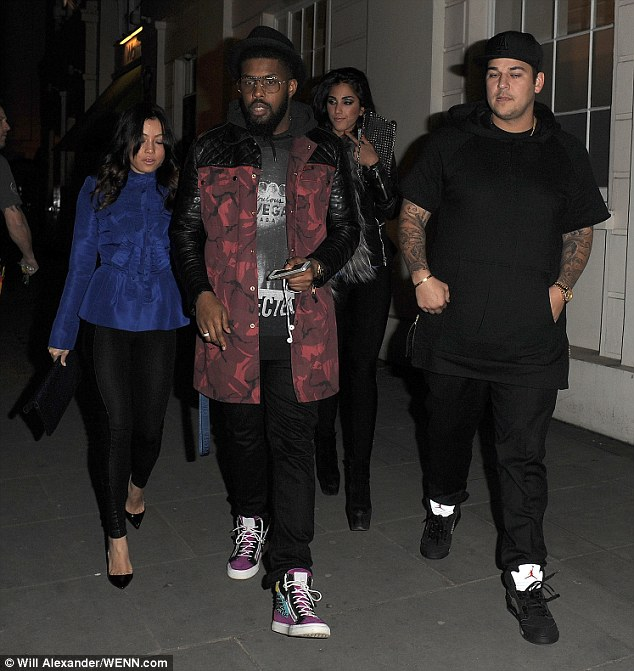 Out together again: Rob Kardashian takes brunette Naza Jafarian out for a second night in a row as he heads out in London once more