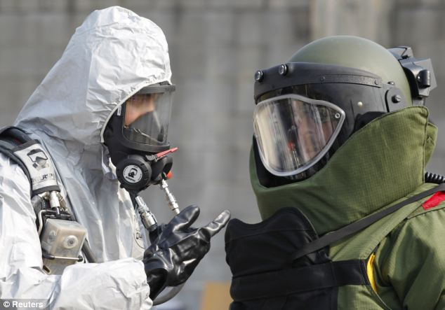 Display: Soldiers of the U.S. Army 23rd chemical battalion try out their equipment as they give a demonstration