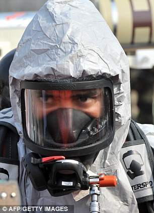 A soldier of the US Army's 23rd Chemical Battalion wears protective gear