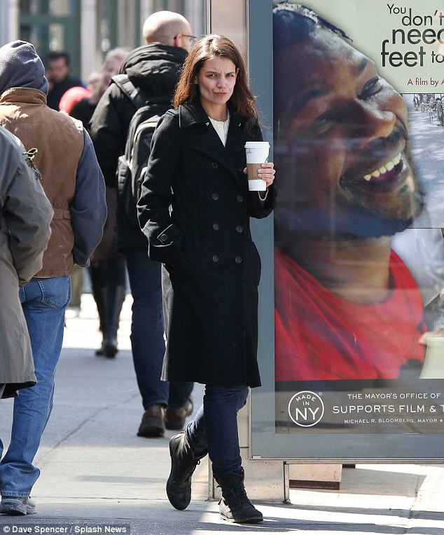 The windy city: Katie was wrapped up warm for her stroll around town as she got her caffeine fix