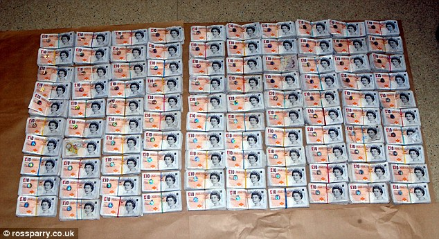 Evidence: Police found these bundles of cash stashed by 38-year-old Detective Constable Nicholas McFadden