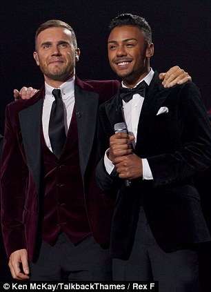 Claim to fame: Gary Barlow and Marcus seen at the The X Factor Live last year