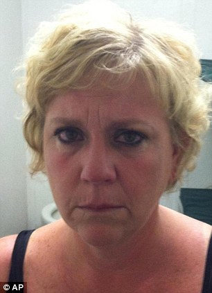 Suspect: Erin Henton, 45, an assistant principal, was arrested for unlawful conduct with minors who were her students