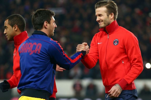 No great shakes (the one on the right, anyway): Beckham greets Messi before the Champions League game