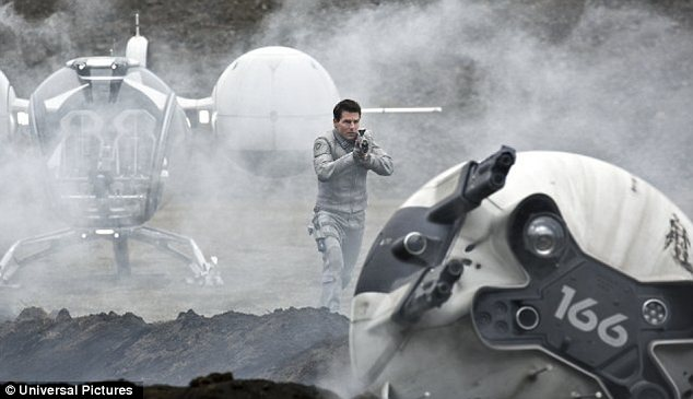On screen: Cruise plays 37-year-old former Marine Commander Jack Harper - one of the last few drone repairmen stationed on Earth, which was nearly destroyed by an alien invasion 60 years earlier