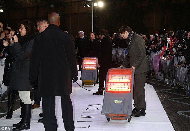 Trying to raise the temperature: Organisers of the screening brought heaters to try and warm up the stars as they made their way up the red carpet