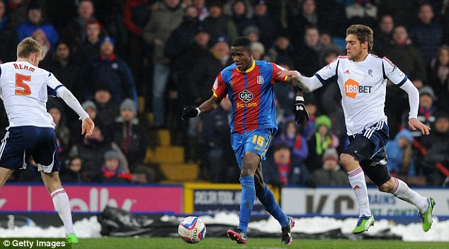 Race: Wilfried Zaha has six games to help Crystal Palace win promotion before moving to Manchester United and we've imagined how he'll look in the red of the champions-elect (below)