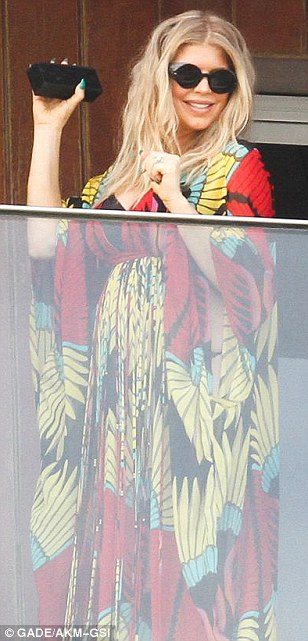 Pregnancy glow: The singer looked relaxed and happy as she greeted her fans from her hotel balcony