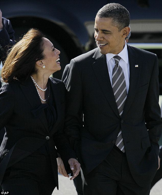 Political pals: President Obama, seen here with Kamala Harris in February 2012, called her 'the best looking Attorney General' in the country at a fundraiser on Thursday