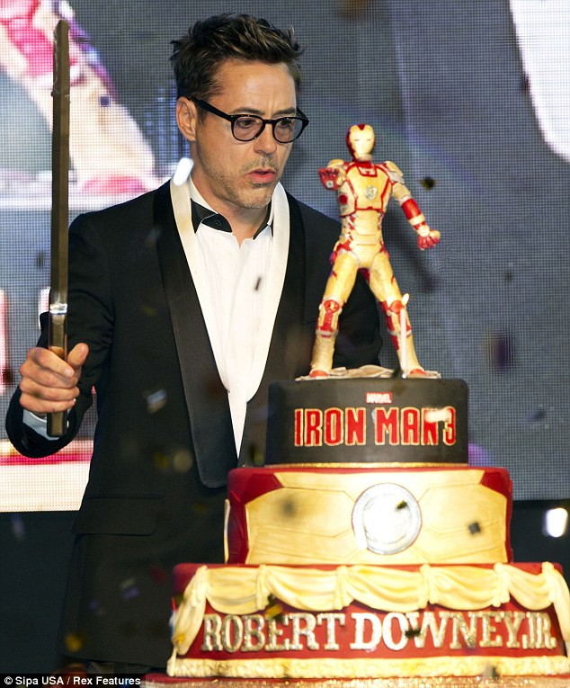 Show no mercy: The star cut his giant cake with an equally large sword