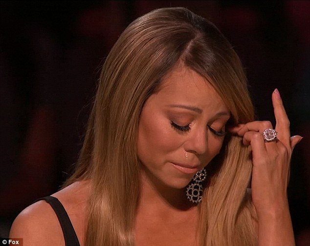 Moved to tears: Mariah Carey was bawling after Burnell Taylor's shock eviction on American Idol on Thursday