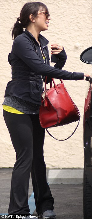 Casual wear: Cheryl Burke wore jogging clothing and sunglasses for her day at work