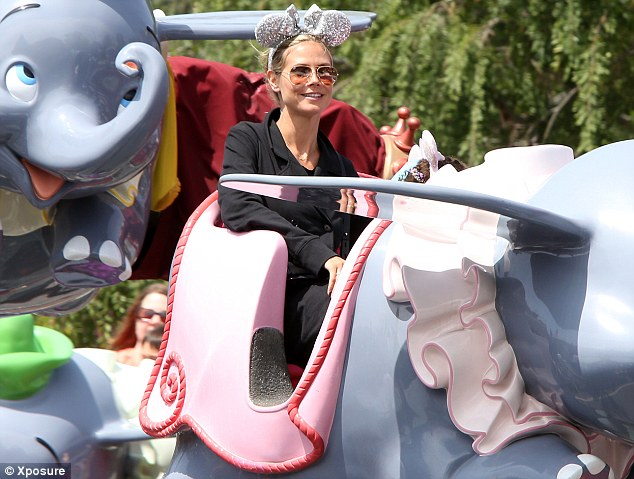 Enjoy the ride: The supermodel sat back and relaxed with her kids at the happiest place on earth