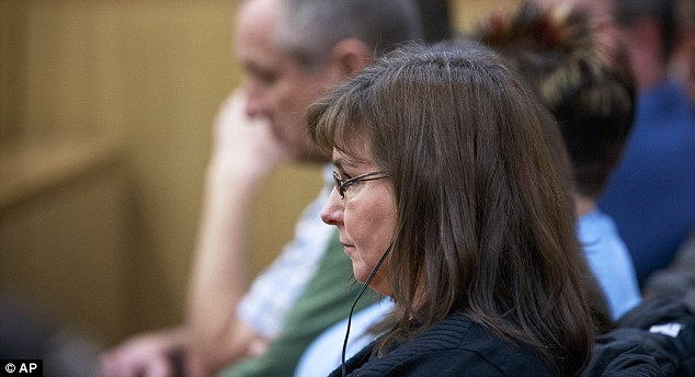 Support: Defendant Jodi Arias' mother Sandy Arias listens as her daughter testifies about killing Travis Alexander in 2008 during the murder trial in February