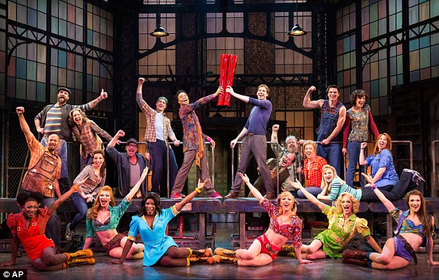 Colourful bunch: The O+M Company shows the cast during a performance of the musical Kinky Boots