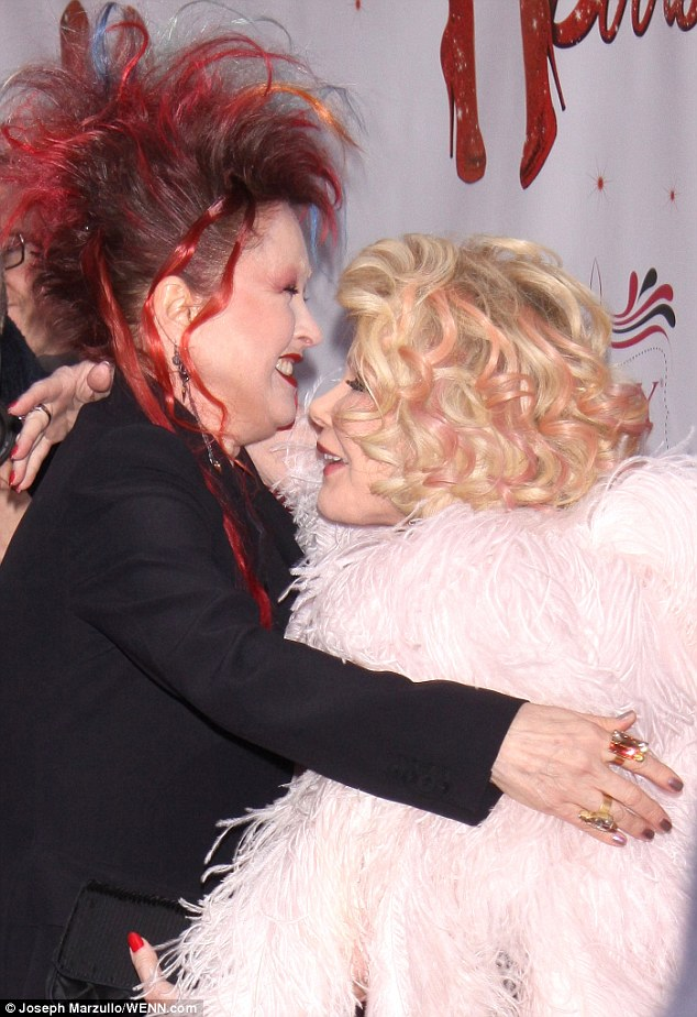 Warm embraced: She also smiled as she hugged Joan Rivers