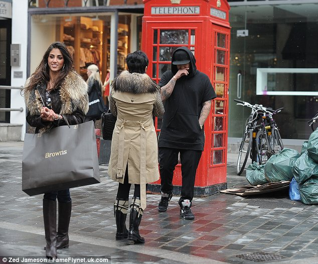 Picking up the shopping: Naza was seen carrying a shopping bag suggesting that Rob may well have bought her a treat