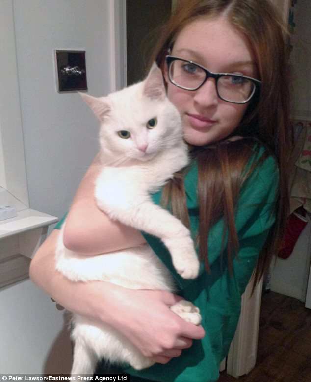 Devoted: Ms Salter's 14-year-old daughter Georgia with Tilly before the cat was killed