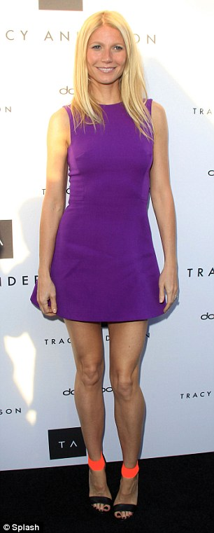 Pretty in purple: His wife Gwyneth has been busy promoting her book in LA this week, see here celebrating the Opening of the Tracy Anderson Flagship Studio on Thursday night