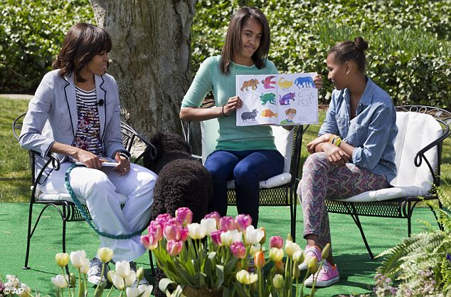 The girls: Michelle, seen here with Malia and Sasha at the annual Easter Egg Roll on Monday, has repeatedly said that her main priority is being 'mom-in-chief'