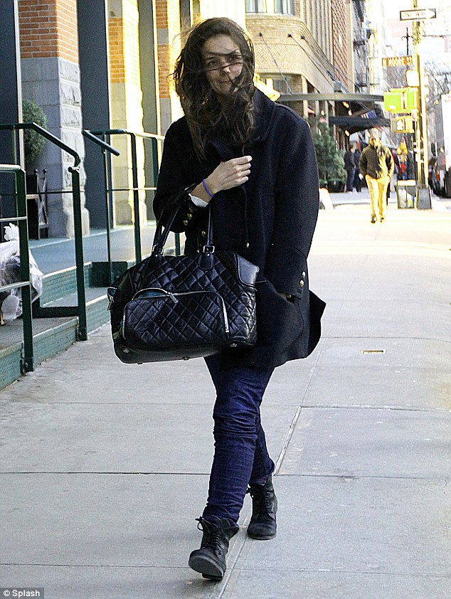 Under wraps: Katie Holmes tried to shy away from the crowd as she battled the winds on a walk in New York City on Friday