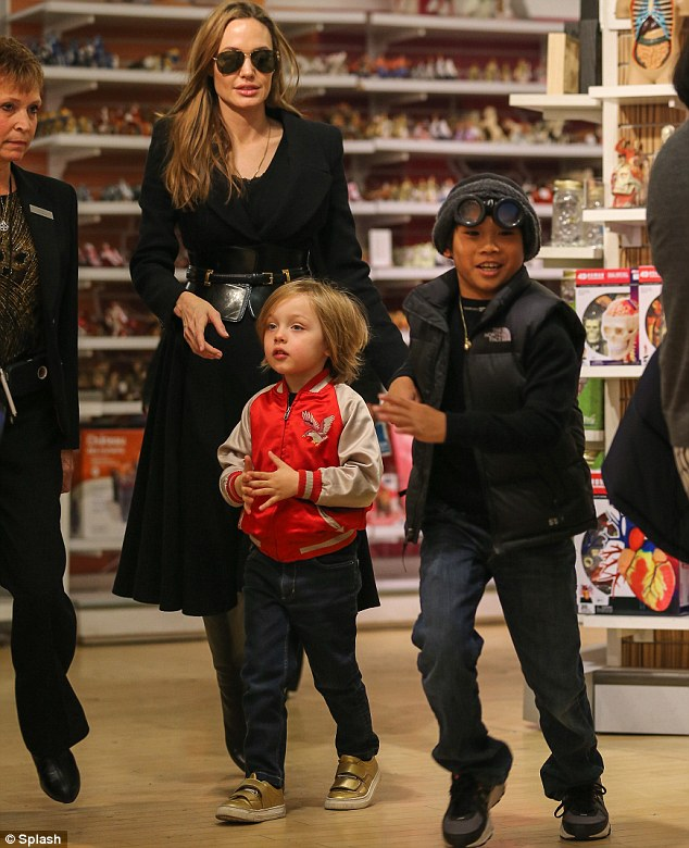 Like a kid in a...toy store: Angelina and Brad's little ones seemed to thoroughly enjoy their time checking out some new goodies