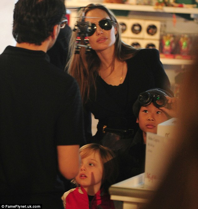 Can we have one? Angelina, looking glamorous in her sunglasses indoors, and her boys loved the flying robot