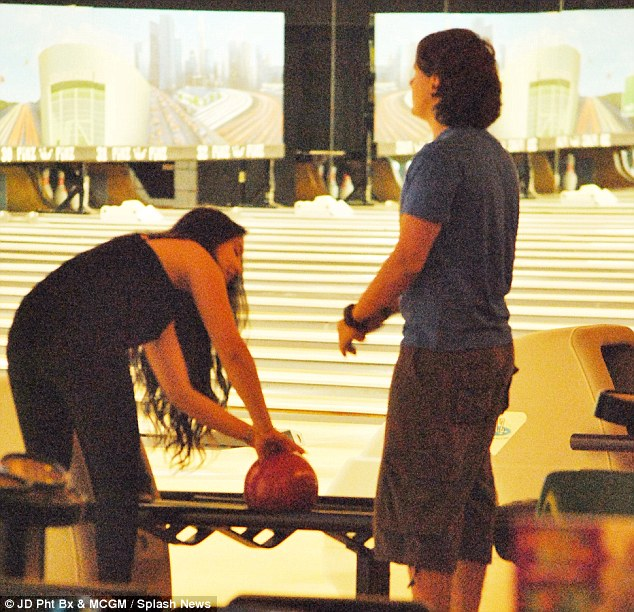 Too heavy? Prince's friend seemed to struggle getting her fingers through the bowling ball