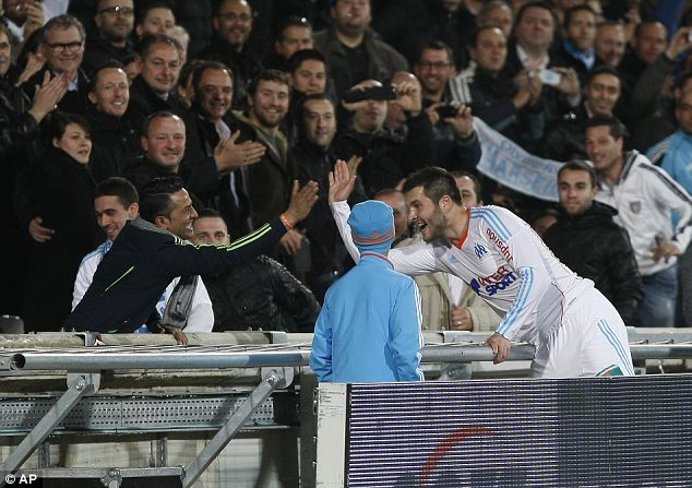 High fives: Gignac celebrates his strike with a fan