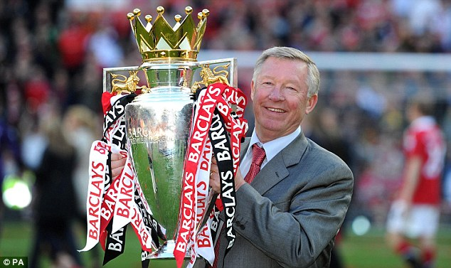 Trophy life: Sir Alex Ferguson celebrates the title in 2011
