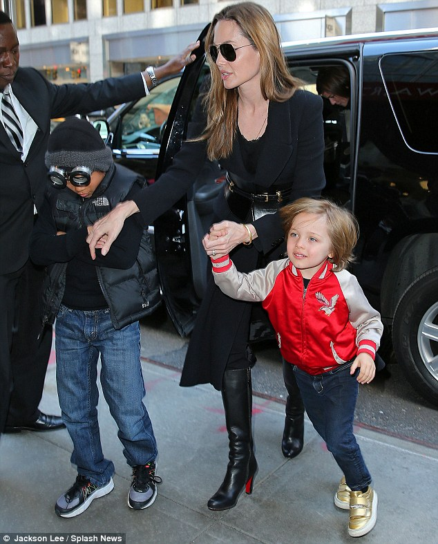 Toy story: The Jolie-Pitt kids made their way into FAO Schwarz with their glamorous mother between them