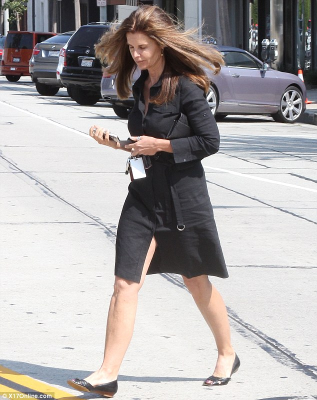 Bad hair day: An unfortunate gust of wind undid some of the good work she had done at a posh salon