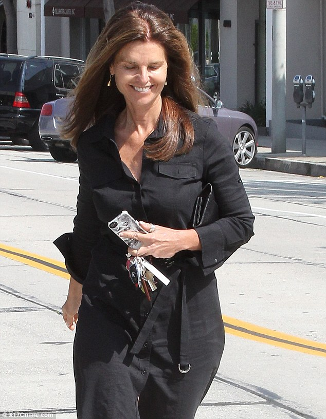 Keeping her family close: Maria Shriver was spotted with a family photo phone cover in Beverly Hills on Friday