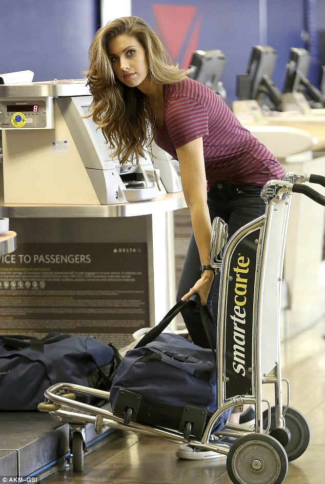 Skipping something? Katherine Webb was nowhere near the pool and instead was at LAX preparing to fly out of Los Angeles, California