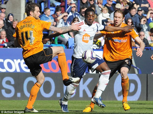 Double team: Bolton's Marvin Sordell runs into Roger Johnson (left) and Kaspers Gorkss