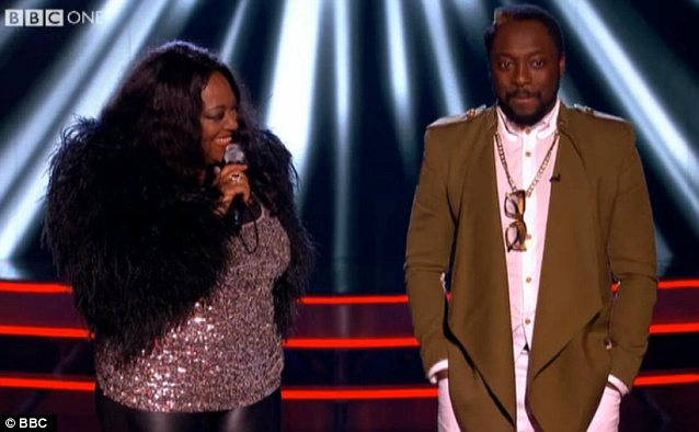 Americans united: Will.i.am joins Kym onstage after her performance