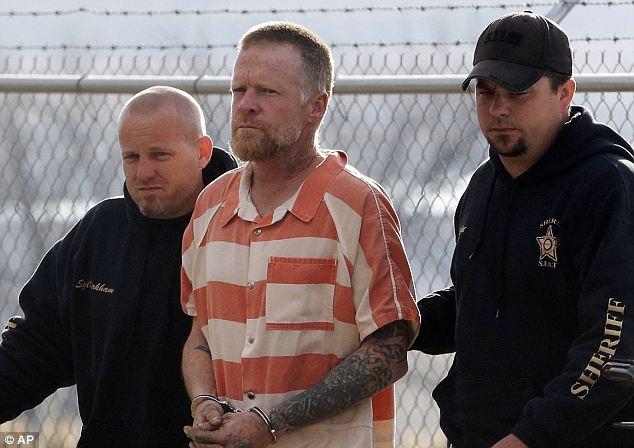 Sanpete Sheriff's Officers escort Troy James Knapp, 45, to the Sanpete County Jail Tuesday, April 2, 2013, in Manti, Utah. Authorities captured Knapp, an elusive survivalist who is suspected of burglarizing Utah cabins