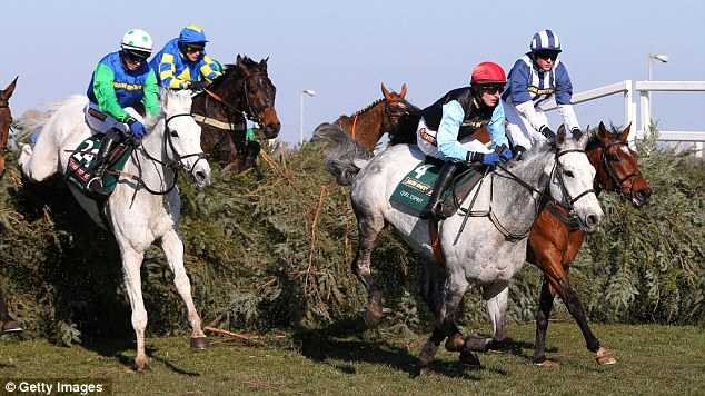 Victory: Ryan Mania, pictured here second from the right, won the Grand National with Auroras Encore